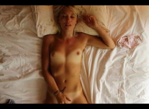 Suntanned ash-blonde woman wanks at home