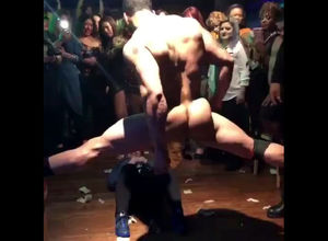 Muscular masculine stripper dancing in..