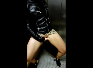 Fetish damsel in ebony flesh jacket..