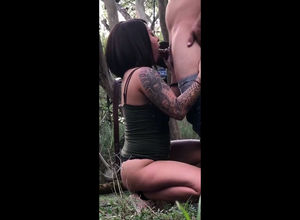 Warm tatted black deep-throat in woods