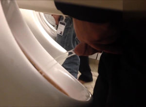 Voyeur near urinal display intense jets