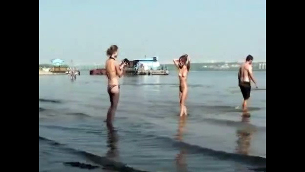 Nude damsels on the beach for swingers..
